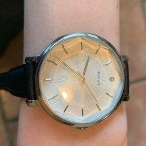 Fossil black wrist watch.